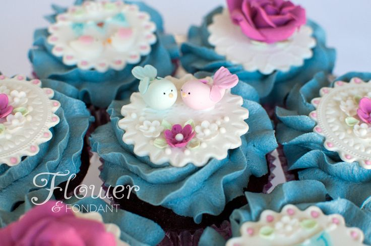 Love BIrd Cupcakes. These love birds sit on top of a stamped fondant topper. Perfect for a pretty high tea engagement party.