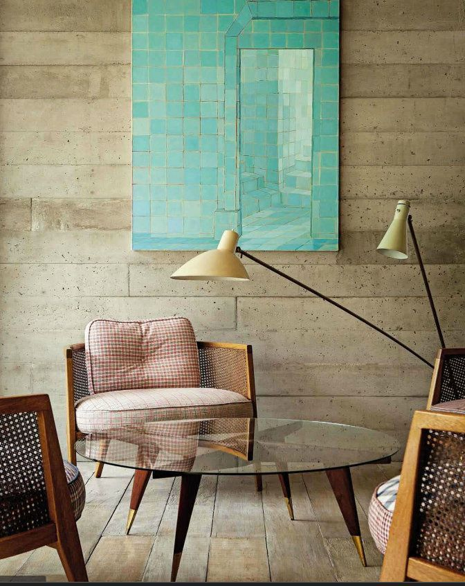calm and chic living room or casual sitting room - love the aqua painting on those warm walls with modern lighting for contrast