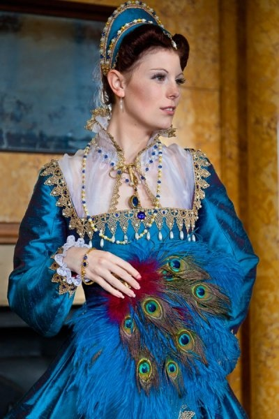 A blue Elizabethan gown with pearls.