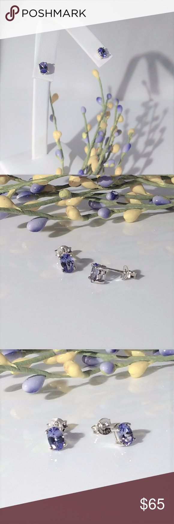 Elegant Tanzanite Gemstone Earrings These highly desirable light violet blue tanzanite gemstones measure 6x4mm each and are 0.9 carat tw. The exquisite genuine tanzanite earrings are on platinum over sterling silver posts. This pair of lovely earrings are sure to be a favorite. New.  Measurements and weights are approximate. Photos may be enlarged to show detail. Tanzanite Jewelry Earrings
