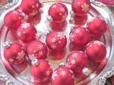 Colorful ornaments sparkle on this silver tray.   Photo courtesy of Glenna Morton. If you've been storing your best silver in the closet during the past year, take it out, polish it, and make it the center of attention on your Christmas table. We used matte red balls with silver snowflake designs that compliment the silver tray beautifully.   Materials for Christmas Silver Tray of  Ornaments Centerpiece: silver tray or platter,   pretty and colorful holiday ornaments and balls,   holiday…