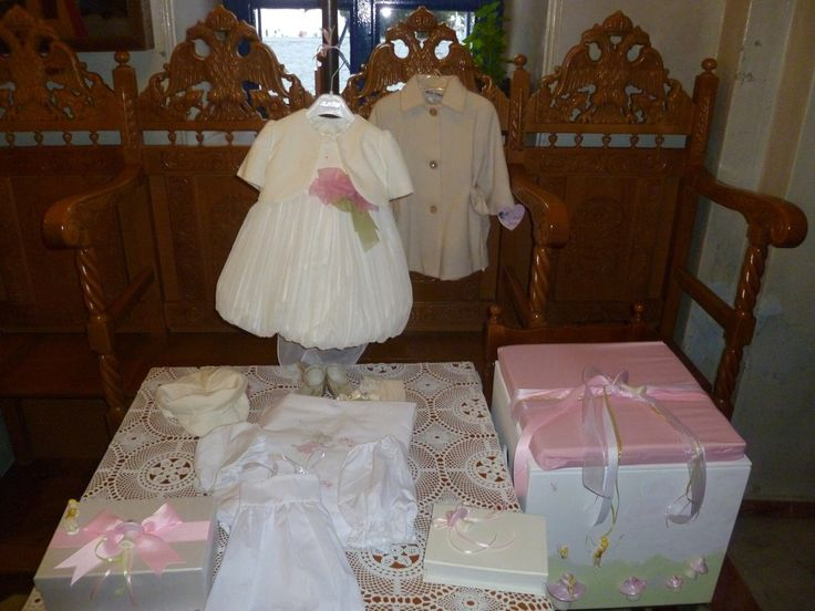Girl's christening set that includes the christening gown, wooden accessory box and oil set.