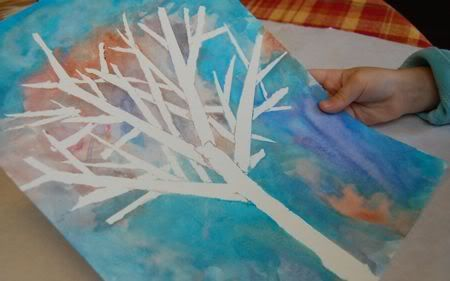Water color silhouette - Winter tree. Outside, not variations in branch sizes and shapes. Masking tape, paper, watercolor paint. MODIFY to add child's fingerprints in various colors for a FALL tree. Could make all 4 seasons.