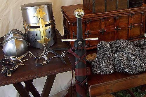 Thirteenth century helm, spurs, poleyns, sword, scabbard, and mail hauberk