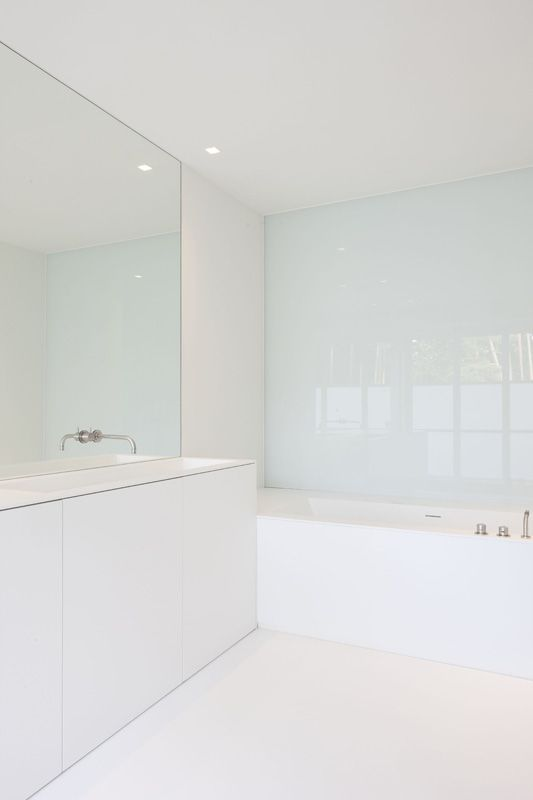 | BATHROOMS | lovely use of glass and white frameless detailing. All-white bathroom by Belgian architects Minus. #bathrooms #minus