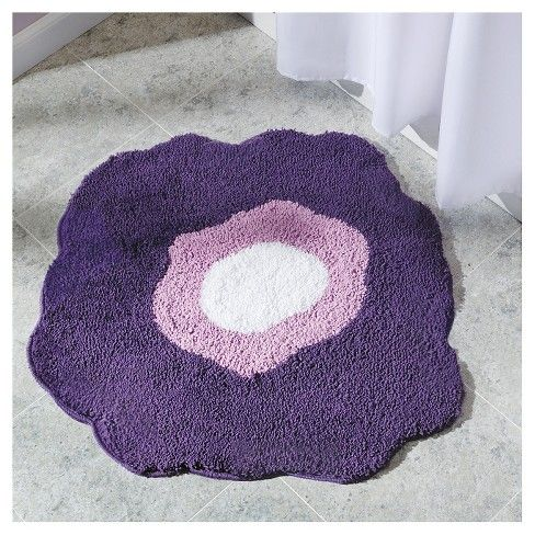 "<p>The InterDesign Poppy 2 Microfiber Rug puts the fun in functional with an eye-popping red flower. A small rug with large presence, its bright colors show off its personality. 100% machine woven microfiber rug construction will keep your tootsies comfy on the bathroom floor. A 100% latex backing keeps this bath mat in place. Also available in green, purple and yellow. Dimensions: 30""x27.5""</p>"