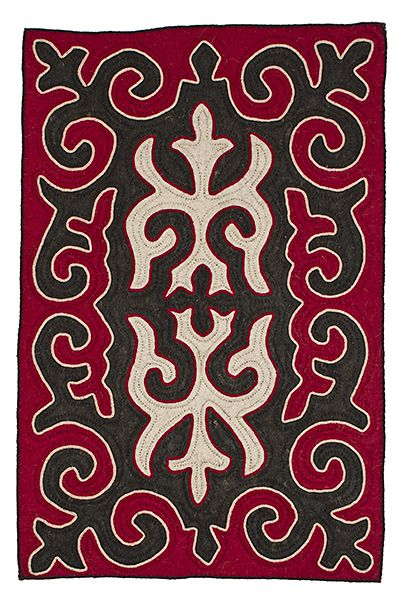 Small tri-coloured shyrdak rug from Felt combining all-natural, un-dyed, white and dark brown wool felt with a red coloured wool felt and braid in white and brown wool 0.7m x 1.1m feltrugs.co.uk
