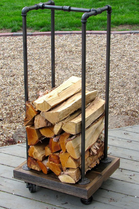 Rustic Firewood Rack for neatly stacking your logs for burning. Perfect for the hearth or fireplace, this piece is finished in a rustic/industrial style using cedar and metal pipe fittings. The Rack measures 17 x 20 at the base and stands 43 tall. It is fitted with 3 metal casters for added mobility and industrial style. Ready to ship