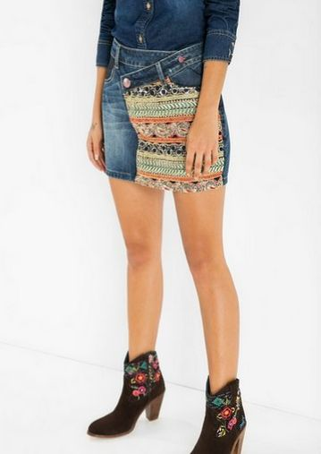 Denim miniskirt with an asymmetric fastening and embroidered, gold and sparkly ethnic-style details.