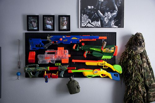 Finally, a solution to all the Nerf Guns lying around the house! Maybe drill a hole in a coffee can and hang it with a chain to store the bullets in.