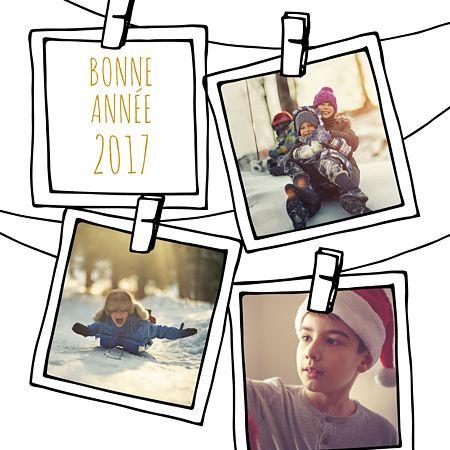 Jolie carte de voeux au fond blanc façon DIY et polaroids accrochés avec des pinces à linge, pour souhaiter une bonne année de façon originale et élégante. Intégrez vos photos pour souhaiter une bonne année 2017 !
