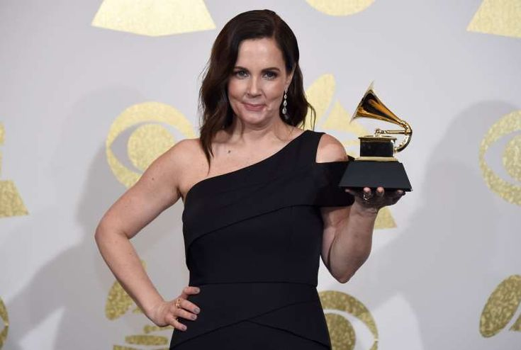 """2017 Grammy Award Winners - February 13, 2017:  BEST COUNTRY SONG -  Tim McGraw for """"Humble and Kind"""" (award announced previously)  Pictured: Accepting the award is songwriter Lori McKenna."""