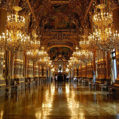 Palace of Versailles: The hall of mirrors lit up. In the time of Louis the 14th there were tall candelabras made of gold lining the floors which made the room sparkle even more-so.