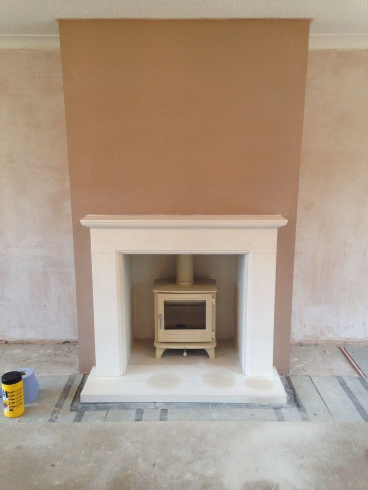 False chimney breast built by Colesforfires.co.uk using limestone surround and Chesney Salisbury Woodburning stove.