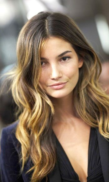 With this style, Lily Adridge's signature look, the first layer should start around the chin area to offset the look of a strong jawline. It's also a good idea to have all of the layers turning inward, not outward, so that it narrows the face a bit.  -Cosmopolitan.com