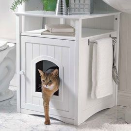 Kitty Washroom  Furniture disguises the litter box.  Forget bulky plastic covers. This cabinet combines good looks and practicality by hiding the litter box with style. It also gives you additional storage and display space in any room.  So need