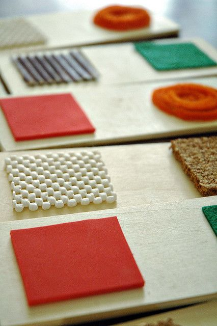 Homemade Texture Dominoes. Textures include red craft foam, green felt, corrugated cardboard, corkboard, rubbery shelf-liner and chenille stems cut into 2 inch squares and hot-glued onto pieces of wood.