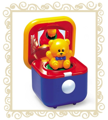 $32.95 The Tolo Musical Surprise Bear lays a delightful melody. Press the large white button for a peek-a-boo surprise. Watch the teddy gently twirl around. Reflective images. Suits 12 months+.