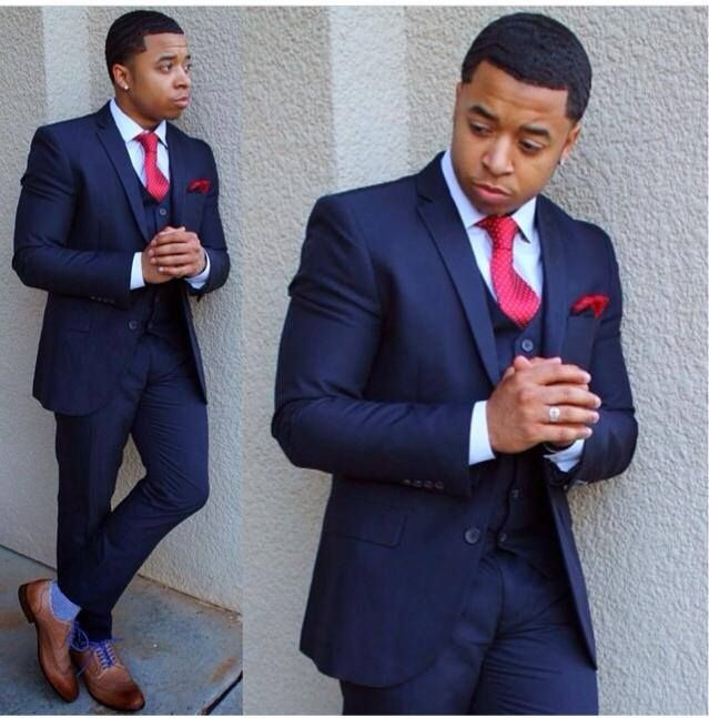 navy blue suit, red tie and brown shoes