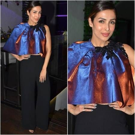 Erm, Malaika – just why?.. While we love the gorgeous #MalaikaArora and are crazy about her style (we love Labelife!) we just don't get this outfit, do you - a holographic, metallic shiny cape (so old school!) worn over a pair of pants. While we love the pants and the hair and even the makeup but this cape from Said Kobessey is confusing us... Get the look at https://www.estrolo.com/whatstrending/erm-malaika-just-why/