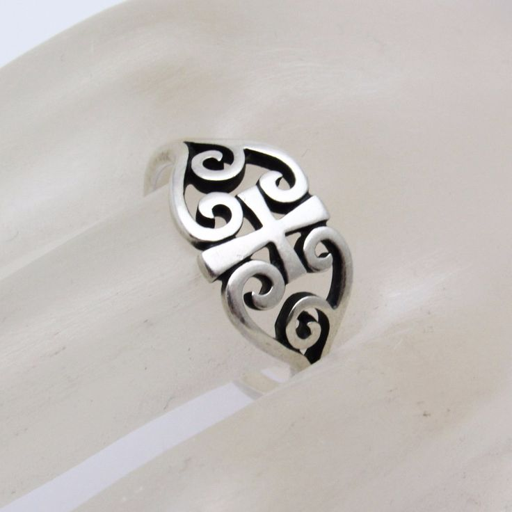 "James Avery sterling scroll cross ring in size 9 1/4. Beautiful ring to celebrate your faith. Excellent pre-owned condition, signed with the candleabra mark and ""ster."""