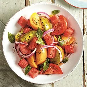 Combine sweet, juicy watermelon chunks with fresh tomato, onion and a red wine vinaigrette for a salad that is the essence of summer./