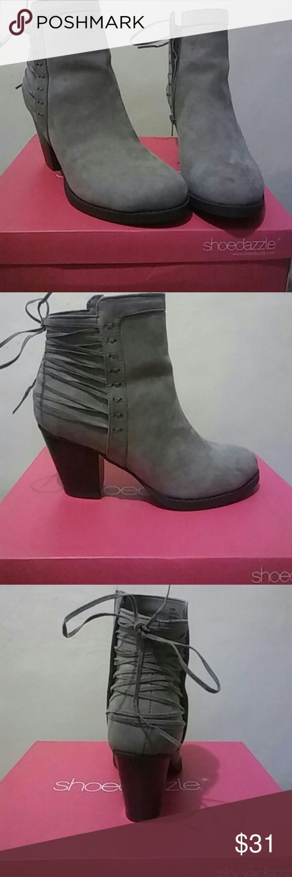 Grey shoe dazzle bootie heel Grey shoe dazzle bootie heel size 8 but it runs big so it fits more for an 8 1/2. These have only been worn around the house for 20 minutes. Shoe Dazzle Shoes Ankle Boots & Booties