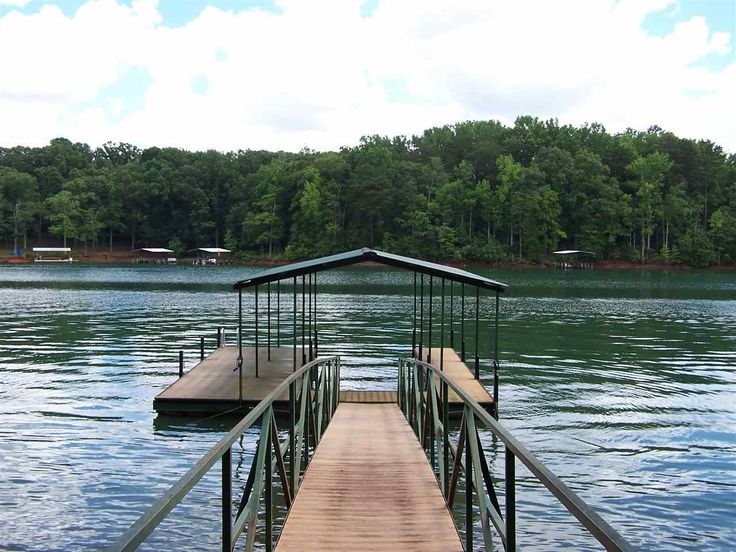 Enjoy the Lake Life at it's best on this Gorgeous Deep Water Home Site with Covered Dock and minutes from Anderson! In addition to being located in prestigious North Shore subdivision, this home site offers fabulous views, deep water(15 Feet at full pool), and 10 minutes to shopping, restaurants, and all the conveniences of Anderson. Dock is a quality built dock with low-maintenance composite decking. Build your dream home in North Shore and enjoy lakeside dining by car or by boat. Locate...