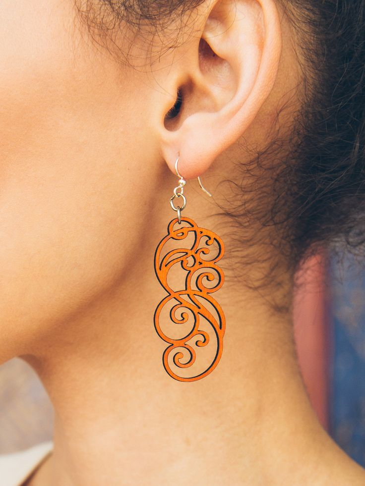 Bold colorful earrings with a elegant scrollwork design. Made from sustainable laser-cut wood, these super lightweight earrings won't hurt your ears. - Made In U.S.A - Wood stained with water-based dy