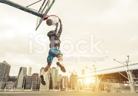 Basketball street player making a rear slam dunk. royalty-free stock photo
