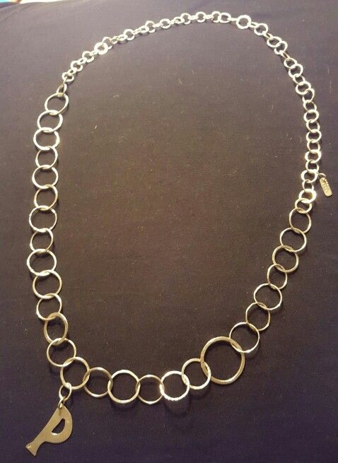 Big P necklace.  80 different handmade rings.