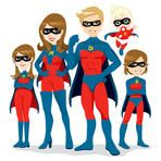 Portrait of beautiful family posing together in superhero costumes with cape