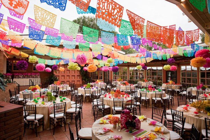 What do you get when you combine hot sauce bottles, ranunculus and papel picado banners? Only the most colorfully gorgeous rehearsal dinner I have ever laid my eyes upon. With a powerhouse of vendors including styling from Jeanie of Details,