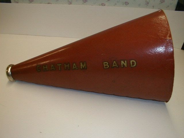 From the archives of Chatham Historical Society, Chatham, MA. Hand held megaphone used by Chatham Town band. Circa 1900s. Red cardboard with gold lettering and metal mouth piece. #atwoodhouse, #megaphone, #chathamband, #chatham, #capecod