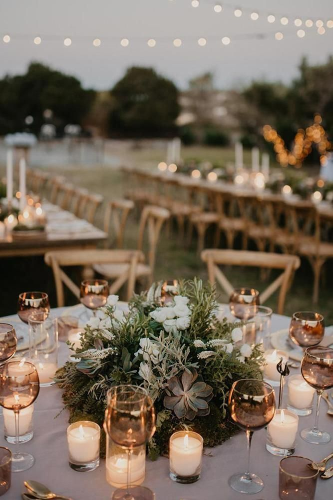 wedding table decorations round with greenery and succulents and cadles paulinaweddings