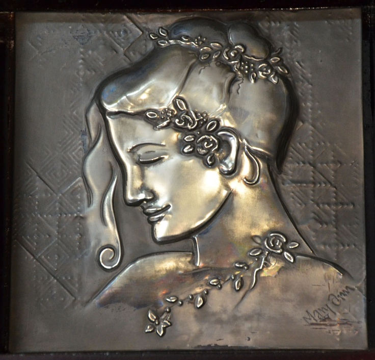 I love creating faces from pewter sheet.