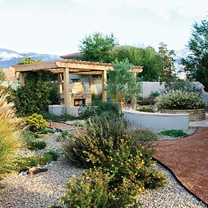Big on features, not on grass   Bridges, islands, and a shaded fireplace add plenty of whimsical details to this Albuquerque backyard­­—no water necessary. And a smattering of carefully chosen drought-resistant plants offer just enough no-fuss greenery to create a lush feel.