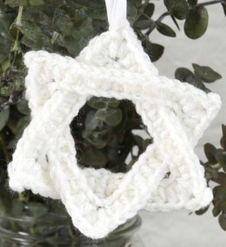 White Star of David Ornament in Red Heart Super Saver Economy Solids - LW3275. Discover more Patterns by Red Heart Yarns at LoveCrochet. We stock patterns, yarn, hooks and books from all of your favorite brands.