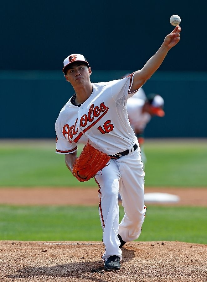 SARASOTA, FL - MARCH 23: Pitcher Wei-Yin Chen #16 of the Baltimore Orioles pitches against the Philadelphia Phillies during a Grapefruit League Spring Training Game at Ed Smith Stadium on March 23, 2013 in Sarasota, Florida. (Photo by J. Meric/Getty Images)