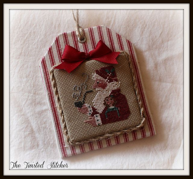 Prairie Schooler Santa from Book 36 by The Twisted Stitcher, via Flickr...love the finished ornament