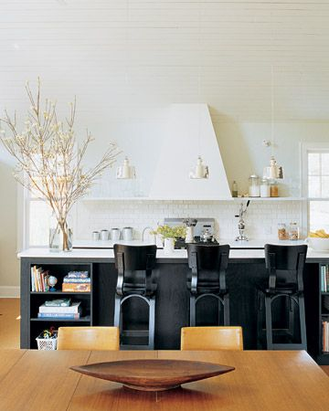 Kitchen Hub:  The owners of this Westchester, New York, ranch home updated the kitchen to include a marble-topped island and three Thonet bentwood stools. It now makes a comfortable hub for quick meals or homework.