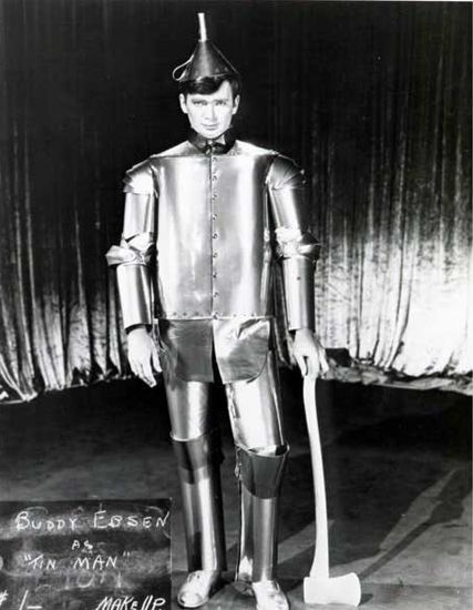 Buddy Ebsen Was Originally Cast As The Tin Man But Was Recast When The Make-up Almost Killed Him. With four weeks of rehearsal under his belt and all the Tin Woodsman songs recorded, Buddy Ebsen was rushed to the hospital when his lungs failed. He'd had a deadly lung infection caused by the silver aluminum dust mixed with clown paint being used as make-up. Ebsen spent two weeks in the hospital and another month recovering at home.
