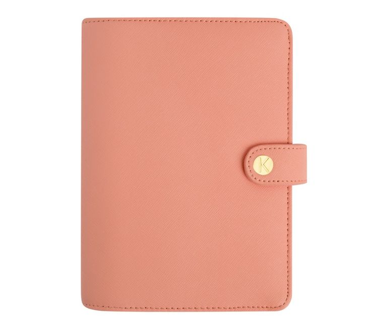 This Textured Leather Planner in peach is perfect for adding a soft, feminine touch to your days.
