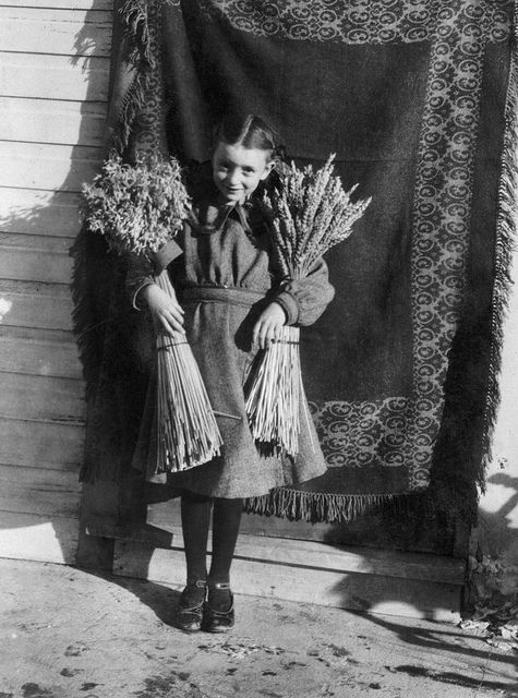 A young lady named Helen Burke holding her winning sheaves of wheat from a school fair, Milo, Alberta, c. 1920. #vintage #Canada #harvest #1920s
