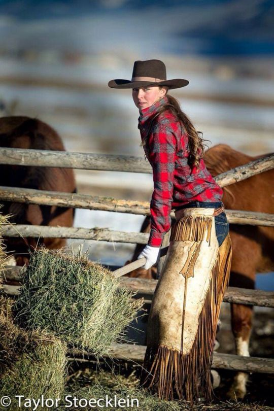 LOL never seen someone feeding horses and wearing chaps for it.however I love this hat