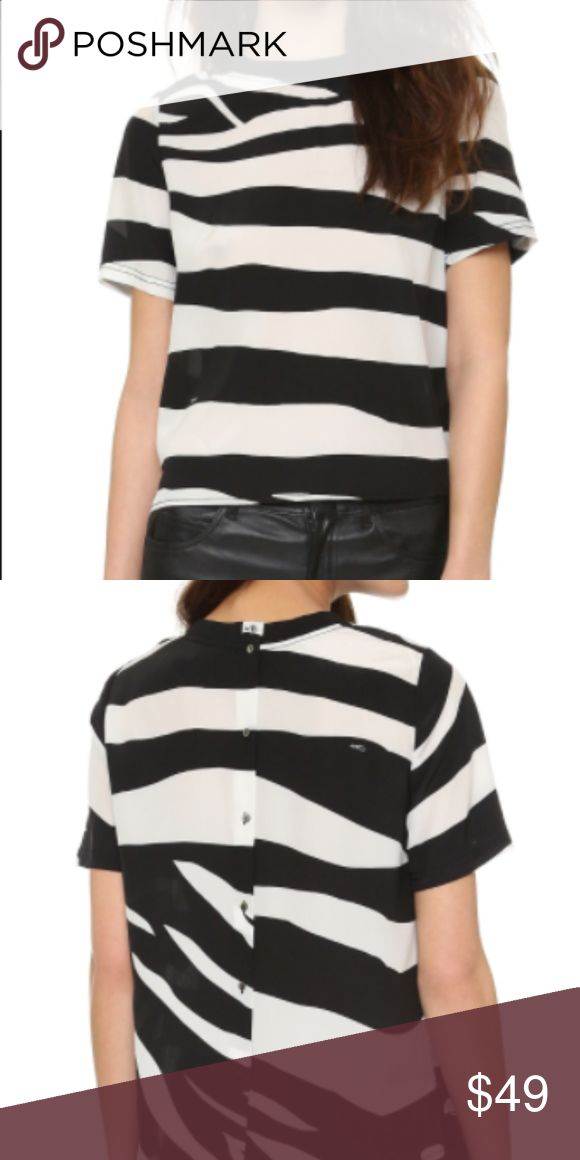 """DVF 100% Silk Zebra Print """"Dayle"""" Top Diane Von Furstenberg 100% silk zebra print top. Button closure in back. Slightly boxy fit. Super chic with a slim pencil skirt or pants. Dry clean. Size S. No trades or lowball offers pls. Thanks! Diane Von Furstenberg Tops Blouses"""