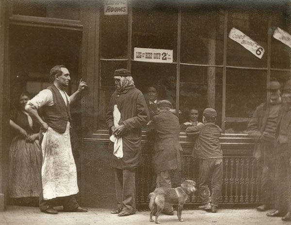 """A Convicts Home  From 'Street Life in London', 1877, by John Thomson and Adolphe Smith.    """"In Drury Lane there is a house which has been celebrated for more than a century. It was a """"cook-shop"""" in Jack Sheppard's time. This notorious criminal often dined there, and it is now still frequented by hungry convicts or ticket-of-leave men, who find kindly welcome and may, If they choose, receive wholesome advice from the owner of this strange establishment…"""""""