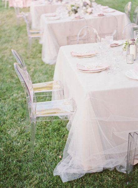 tulle table cloths! You could do a plastic dollar store table cloth with the tulle over top. Inexpensive and beautiful!
