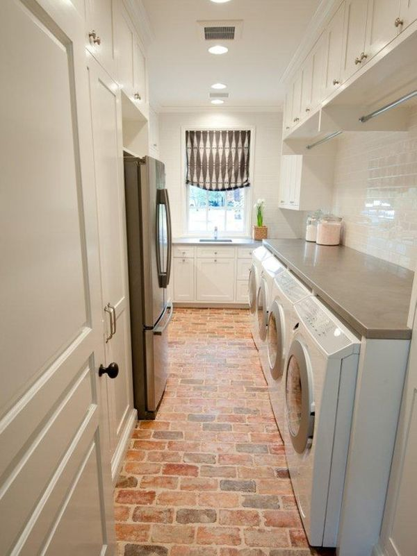 Brick floor in laundry room, a spare fridge, and plenty of room for hanging clothes!