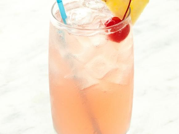 Hmmm..... A definite must try! Add 4 parts tequila, 4 parts coconut rum, 1 part peach schnapps, a splash of pineapple juice, a splash of cranberry juice and ice into a shaker. Shake all ingredients and serve in a high ball glass.